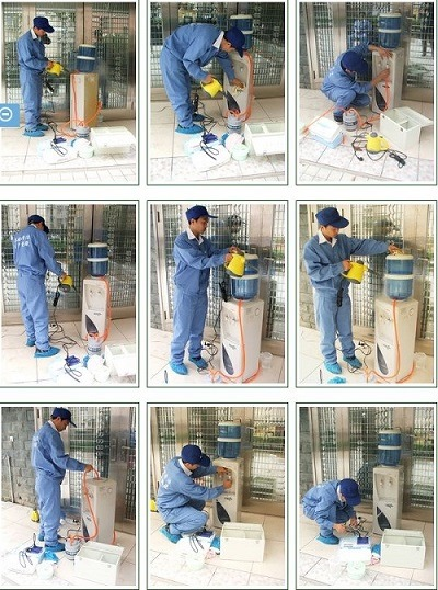 (写真1)ウォーターサーバーの洗浄の様子、かなり専門的な洗浄方法
