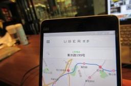 (写真1)中国で利用者を増やし続けるUBER(優歩)